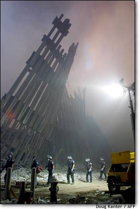 The World Trade Center in ruins as firefighters go about their search